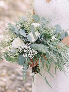 A bridal bouquet with roses and silver brunia want to add burgundy flowers