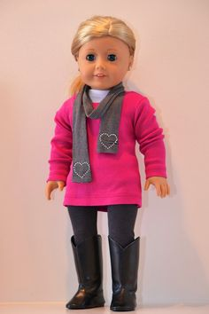 18 inch American Girl Doll Clothing Active wear  by Simply18Inches, 55.00. The black and white striped scarf is made from jersey knit, and has crystal heart accents at both ends.  The fuchsia tunic is long-sleeved with a ribbed neckband. It is seamed halfway up in back, closes with ultra thin velcro at the neck, and slips easily over the head or legs.