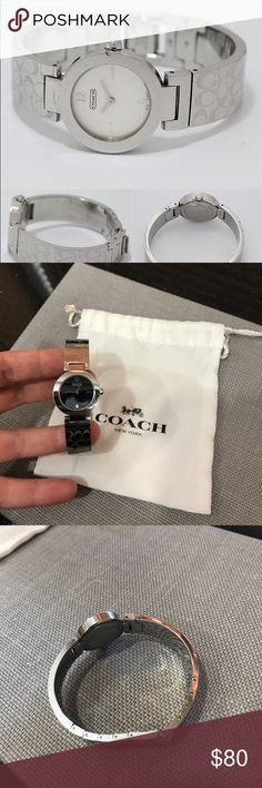 Coach Martha Bangle Silver Watch Adjustable Authentic Coach stainless steel Martha Bangle women's watch (style 0185). Features a stainless steel watch case, a black dial, a Coach logo printed stainless steel watch band, and a fold-over clasp closure. Water resistant 3ATM. Swiss quartz movement.  Worn with love by my mom so there is scratching on the metal but not on the glass.  The band could be made smaller at a watch shop by removing links. Coach Accessories Watches