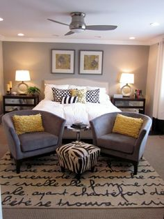 Grey and yellow bedroom.  i like everything but that horrific ottoman