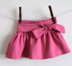 Knot Me Tie Me Skirt -  Make an adorable Knot Me Tie Me Skirt for your little girl with this free sewing project. It has a gathered skirt and a tie in the front for a fashionable accent. #Easy to make and perfect for #fall, this project has it all!