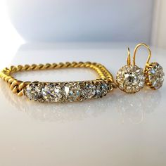 Grace's favorite bracelet  5.51 carats of cushion and old european cuts with cushion and old mine cut diamond earrings