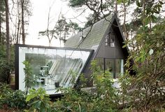 A-frame with an extension - Belgium (via Dwell magazine)
