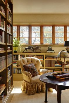 A library-like sitting room with custom bookcases adjoins the second-floor guest room. / Craig Dugan