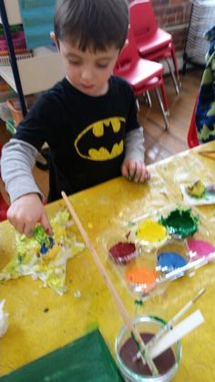 Textured (tissue papered) stars and paint. Just like Eric Carle!