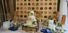 doughnut wall and doughnuts on spindles with cake in center