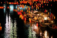 Candle-lit lanterns over the water