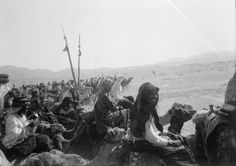 Guerrilla Campaigns 1917: a snapshot taken by T E Lawrence from the back of a camel showing Emir Feisal bin Husain al-Hashimi and Sherif Sharraf leading the Ageyl bodyguard northwards on the first stage to Wejh.