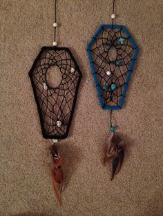 Inspiration only. Take a wire coat hanger and bend it and wrap in black pipe cleaners to make a black coffin dreamcatcher
