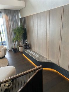 Custom Joinery, Cladding, Furniture | FFC Custom Joinery Fireplace Is made up of Sprayed Duco Slats Cladding the base, with Concealed LEDs to illuminate the feature, Grey Marble Top, with Custom Steel Plate, Stained Calm White Oak Wall Cladding #custom #fireplace #concealedleds #customsteelplate #ffcjoinery #greymarbletop #stainedcalmwhiteoakwallcladding #sprayedducoslats Marble Wall, Marble Top, White Marble, Custom Fireplace, Wall Cladding, Steel Plate, Tv Unit, White Oak, Joinery