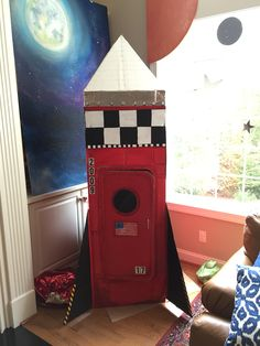 Rocco's Rocket: we built this Rocket out of cardboard boxes for his space birthday party! #rocket #spaceparty #redrocket #spaceship