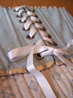 Sew your own corset - I never would have dreamed of using zip-ties for boning! Just tape them together. Wow!