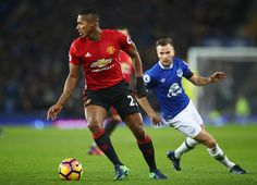 Antonio Valencia of Manchester United evades Tom Cleverley of Everton during the Premier League match between Everton and Manchester United at...