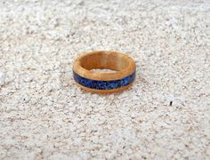 Recycled Oak with Lapis inlay wood ring by DonBurdaDesign on Etsy  https://www.etsy.com/listing/215644344/recycled-oak-with-lapis-inlay-wood-ring?ref=shop_home_active_1