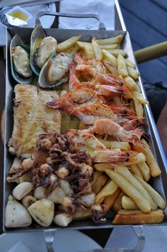 The freshest Seafood platters available - you can watch the fishermen bringing in their daily catches while seated at coastal restaurants. Taken in Cape Town, South Africa