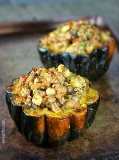 Stuffed Acorn Squash - roasted and filled with a hearty sausage-apple stuffing with sage. Very filling! 292 calories or 7 Weight Watchers SmartPoints each. www.emilybites.com #healthy