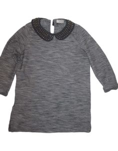 camiseta cuello bebe Pull and Bear 14.00€