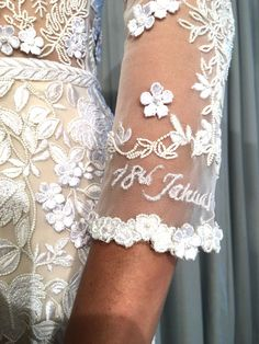 Hermione de Paula floral and embroidered wedding dress- This Bridal Designer Is Setting a New Trend for Hidden Messages and Symbols in Her Gowns#wedding  #weddinggown #bride #bridal #weddingstyle #weddingflowers #weddinginspiration  #weddingfashion #weddingdetails #weddingpictures #weddingflowers #whitegown #floralpatterns   #bespokeweddinggown #hermionedepaula #floralgowns #HdePbridal #collection #handmade #luxurybridal  #sayyestothedress #couture  #couturedress #pieceofart #floral #elegant