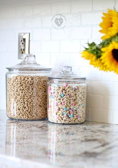 Cheerios and Lucky Charms in glass jars on my kitchen counter. Adds a warm, char. Cheerios and Lucky Charms in glass jars on my kitchen counter. Adds a warm, charming, and kid friendly energy to our family kitchen Kitchen Jars, Family Kitchen, Farmhouse Style Kitchen, Modern Farmhouse Kitchens, Home Kitchens, Kitchen Decor, Kitchen Counter Decorations, Country Kitchen, Kitchen Ideas