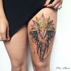 Big Elephant Thigh Tattoo with a Pop of Color