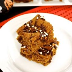 Pumpkin Rolo Blondies are pumpkin spice blondies with Rolo candies baked inside, for pumpkin-chocolate-caramel goodness in every bite!