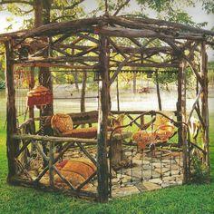 This gazebo looks like it was handmade in the backyard. Very rustic and beautiful!