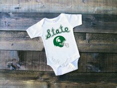 A personal favorite from my Etsy shop https://www.etsy.com/listing/479846193/michigan-state-football-shirt-michigan