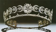 Duchess of Teck Tiara  Queen Mary inherited the tiara from her mother. This tiara is set with diamonds in tiers holding aloft the sheaves of wheat made in gold and silver.