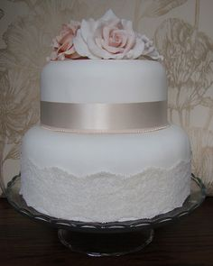 Delicate Shabby Chic Wedding Cake With a Ribbon of Grey Sugar and Lace At It's Base