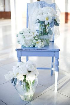 musicchick48:    musicchick48:  this is just too much awesomeness for me to handle!!!!!  a blue chair, a really cool shapely chair!  with gorgeous white flowers and blue ribbons!  and there's lace, and lots of white background!  oh there will be pretty things like this in my home someday!