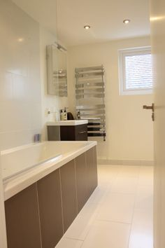 Neutral bathroom.  Loft Conversion in North West London built by Simply Loft