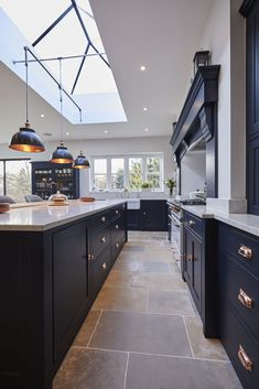 Our latest kitchen project Guildford mixes dark cabinetry with contrasting Carrara quartz worktops and accents of copper to create a truly spectacular kitchen! Kitchen The Main Company Open Plan Kitchen Dining Living, Open Plan Kitchen Diner, Living Room Kitchen, Home Decor Kitchen, Rustic Kitchen, Home Kitchens, Modern Kitchens, Diy Kitchen, Kitchen Furniture