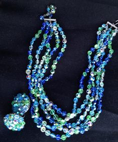 Sparkling blue and green vintage crystal on by TwoSwansSwimming