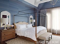 A vaulted ceiling and rustic beams add volume and detail to this dreamy blue bedroom. - Photo: Werner Straube / Design: Lonni Paul