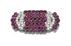 RUBY AND DIAMOND BROOCH, VAN CLEEF & ARPELS, 1934 Of geometric plaque design set with cushion-shaped rubies, highlighted with baguette and ...
