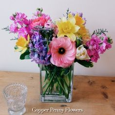 Come Spring, early, with this bright and cheery arrangement featuring hyacinth, daffodils, stock and ranunculus.
