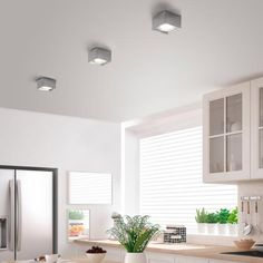 Helestra KARI: Square simple and with lots of power: the bodybuilder KARI is Interior Lighting, Lighting Design, Living Room Designs, Living Spaces, Ceiling Lamp, Ceiling Lights, Lavatory Design, Led Spots, Open Cabinets