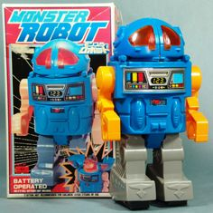 About 10 inches tall and made in Japan by SH - Horikawa. Circa the 1960's, this robot works perfectly - stop and go action with lights, and an opening head that reveals a screeching Godzilla like mons