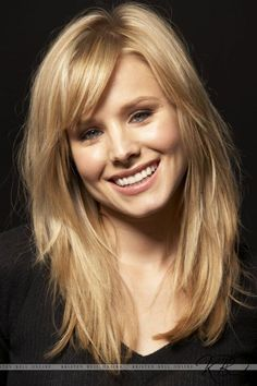 Layered Medium Blond Hairstyle With Bangs