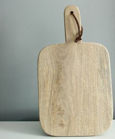hand crafted mango wood chopping board by knead home | notonthehighstreet.com