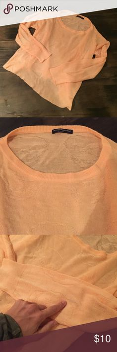 Brandy Melville Peach thin skull sweater OS XS / s Pale orange peachy / pastel coral colored skull sweater top but Brandy Melville - has a very slight mark on sleeve which you can barely see when on. And slight piling on sleeves (see photos) this sweater is such a nice color and has a very flattering oversized look that would be appropriate for a size small or XS person and could even fit a medium if you want it a little tighter Sweaters Crew & Scoop Necks