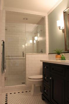 Traditional 3/4 Bathroom with Subway Tile, penny tile floors, frameless showerdoor, Inset cabinets, can lights, Wall sconce