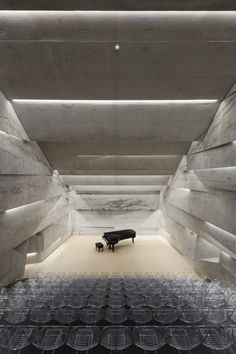 Concert hall in Blaibach by Peter Haimerl is a stone-clad concrete volume which tilts at an angle Minimalist Architecture, Amazing Architecture, Interior Architecture, Landscape Architecture, Interior And Exterior Angles, Hall Interior, Interior Ideas, Concert Hall Architecture, Theatrical Scenery