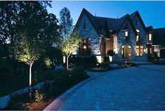 Landscape Lighting 101 - Bob Vila Add beauty and security to your home exterior with planned landscape lighting. Kichler Landscape Lighting, Outdoor Lighting Landscape, Landscape Lighting Design, Outdoor Landscaping, Driveway Landscaping, Backyard Lighting, Tropical Landscaping, Landscaping Ideas, Bob Vila