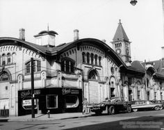 Historic Allegheny City Market House on Federal Street (Now Pittsburgh's North Side) with Carnegie Hall tower behind it.