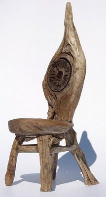 High-backed driftwood chair with knotty backrest by George C. Clark