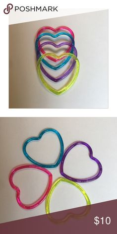 5/$10 heart • glitter • bracelets Pink. Purple. Turquoise. Yellow. Accessorize you little lady or the little darling in your life. Your set will come with at least 1 of each color. Acrylic ccatsmeoww Accessories Jewelry