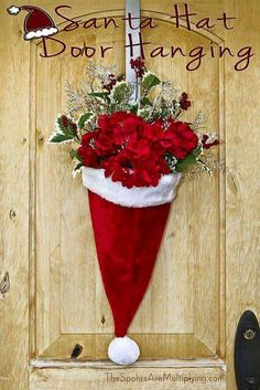 DIY Santa Hat Door Hanging with Flowers. beautiful decoration for outside the home for Christmas time. Noel Christmas, All Things Christmas, Winter Christmas, Christmas Ornaments, Homemade Christmas, Cheap Christmas Decorations, Christmas Centerpieces, Rustic Christmas, Christmas Music