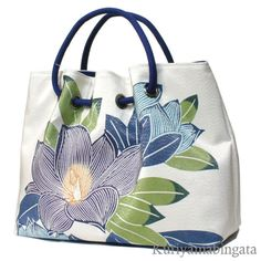 The bag which was made with the cloth for obi of the kimono.