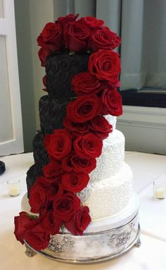 Black and red wedding cake. Black and red themed wedding. Black and red tiered wedding cake. Wedding Cake. Fondant Cake. Red Rose. Wedding Cake. Wedding Planning.